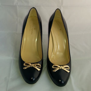 kate spade black pumps with gold bow tie